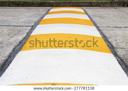 Speed bump for slowing traffic. Selective focus. - stock photo