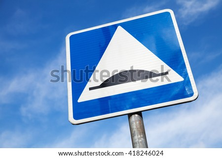 Speed Bump. Square road sign over cloudy sky background - stock photo