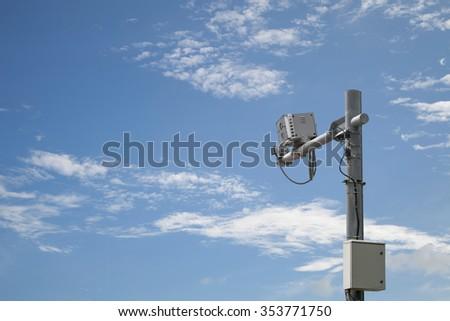 Speed camera box, on blue sky  background  - stock photo