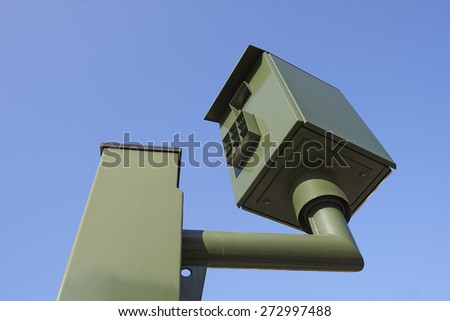 Speed camera control against clear blue sky - stock photo