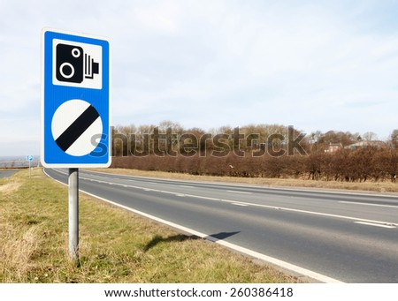 Speed camera warning sign together with the national speed limit sign - stock photo
