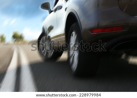 Speed concept. Modern car driving on road - stock photo