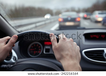 speed control and security distance on the road, driving safely - stock photo