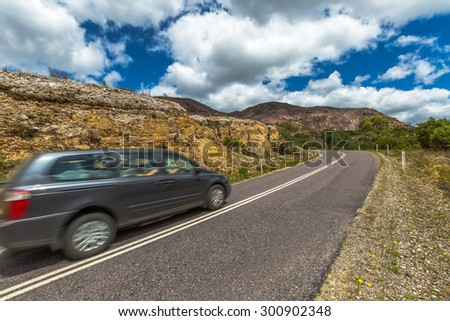 Speed drive along the West Coast to Queenstown into a lunar landscape. Scenic road, Tasmania, Australia. - stock photo