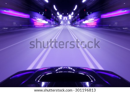 Speed driving car in the night city on the road