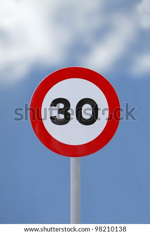 Speed limit road sign - stock photo