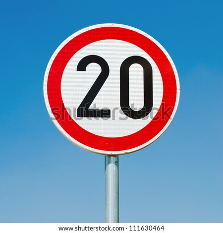 Speed limit sign against clear blue sky. Square composition. - stock photo