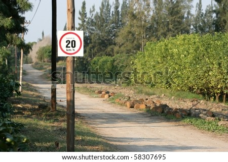 Speed limit sign on wooden pole in the country