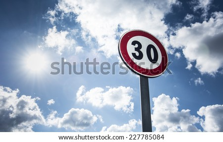 speed limit/sign speed limit sunlit - stock photo