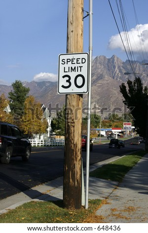 Speed Limit Thirty with Mountains on the background - stock photo