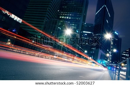 speed morning traffic motion blur in a building centre - stock photo