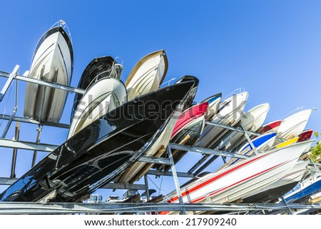speed motor boats are stapled in a garage system in the prestigi - stock photo