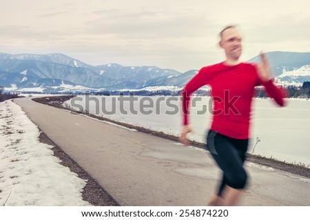 Speed runner on the winter road - stock photo