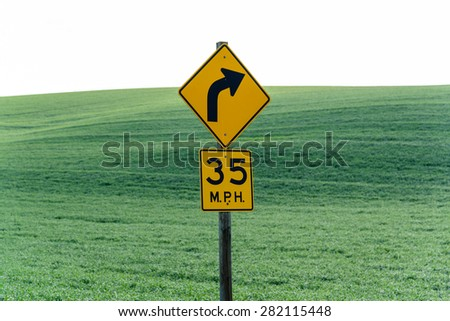 Speed sign at 35pmh with rolling hills in background at Palouse, Whitman County, eastern of Washington state, USA. - stock photo