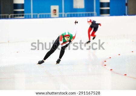 Speed skating young female sportsman during competition race  - stock photo