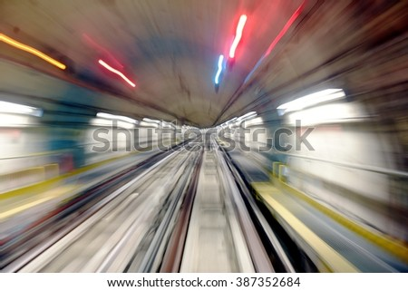 Speed subway tunnels, lights and colors with blurred effect. - stock photo