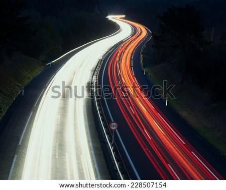 Speed Traffic - light trails on motorway highway at night, A8, Zumaia, Gipuzkoa - stock photo