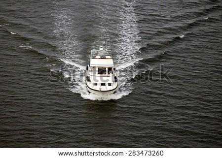 Speedboat seen from above on Littlebelt in Denmark - stock photo