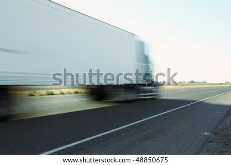 Speeding big truck - stock photo
