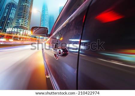 speeding car go through the city - stock photo