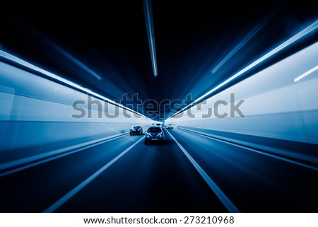 speeding car through the tunnel. - stock photo
