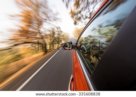 speeding car with motion blur background. - stock photo