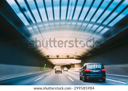 Speeding Cars Inside A Highway Urban Tunnel Motion Blur Background. - stock photo