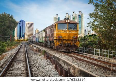 Speeding diesel powered train,Old Train  transport of Thailand - stock photo