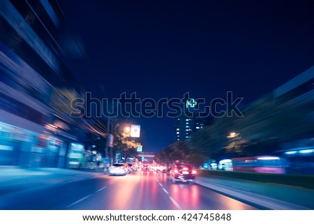 speeding in traffic with hospital in view