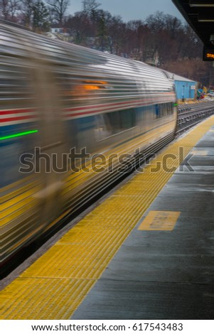 Speeding passenger train loaded with passengers on their commute home