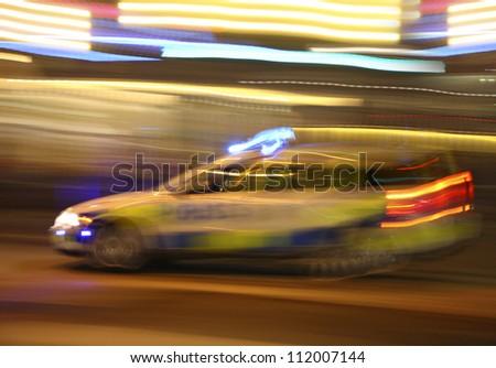 Speeding police car - stock photo