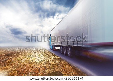 Speeding Transportation Truck driving on highway road through the desert. - stock photo