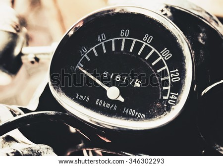 speedometer of vintage motorcycle with retro filter