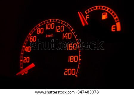 Speedometer on dashboard, fuel tank full - stock photo