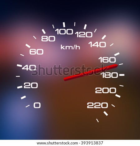 Speedometer over a blurred road representing driving very fast
