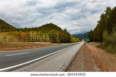 Speedway in autumn forest United States New Hampshire