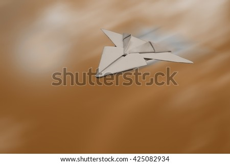 SPEEDY PAPER JET PLANE IN THE BLUR BROWN BACKGROUND (SPACE FOR ADD TEXT) - stock photo