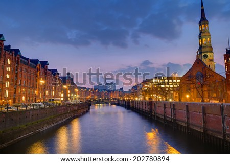 Speicherstadt and church at dawn in Hamburg, Germany - stock photo