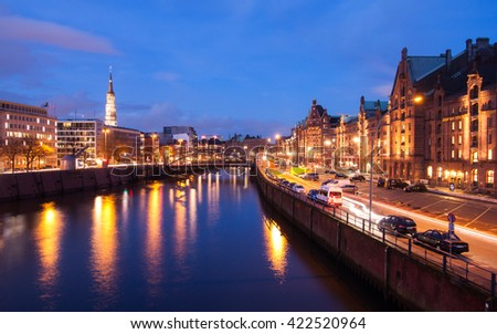 Speicherstadt during twilight in Hamburg, Germany, reflection of lights and buildings on water in canal