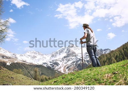 spellbound man observing majestic mountain - stock photo