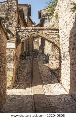 Spello (Perugia, Umbria, Italy) - Typical alley with arch - stock photo