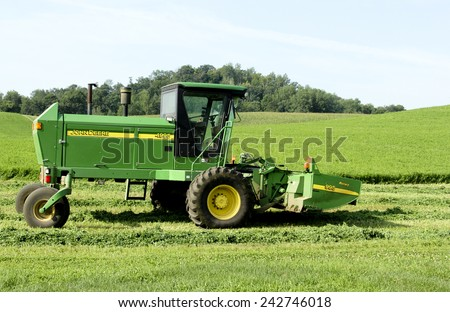 SPENCER , WISCONSIN,August,9,2014 ,  John Deere 4995 Self Propelled Windrower. John Deere is an American agricultural equipment manufacturer founded in 1837 - stock photo