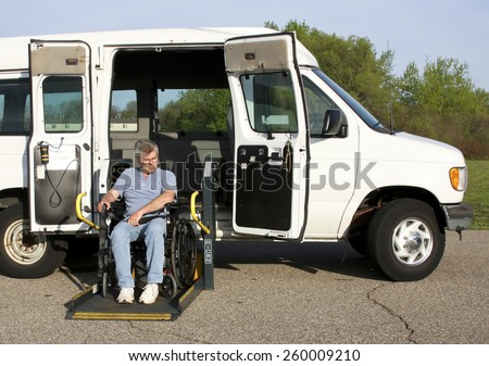 wheelchair lift for van. spencer wisconsin march 12 2015 disabled man using a ricon wheelchair lift for van