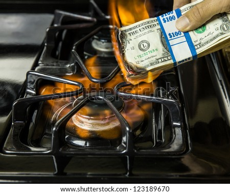 Spend, spend, spend, that is all we seem to do.  Often it does not feel like we are doing much more then burning money. - stock photo