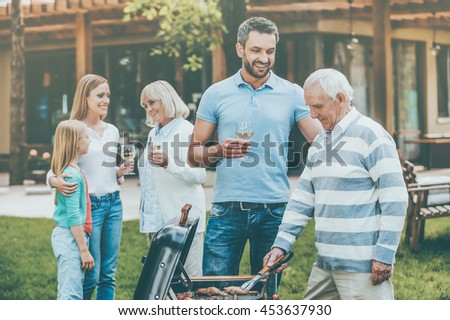 Spending great time with family. Happy family of five people spending time on the back yard together - stock photo