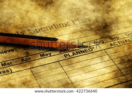 Spending plan grunge concept - stock photo
