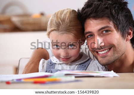 Spending time with his daughter - stock photo