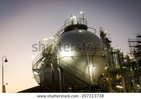 Sphere tank storage gas at dawn petrochemical plant - stock photo