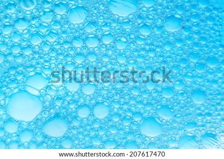 Spherical bubbles extreme closeup. - stock photo