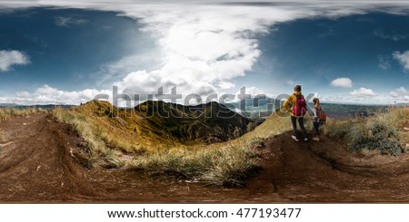 Spherical, 360 degrees, seamless panorama of the two ladies hikers standing on top of the mountain and enjoying volcanic valley view, Bali, Indonesia